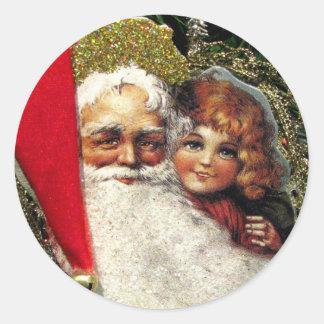Gammalmodiga jultomtenklistermärkear runt klistermärke