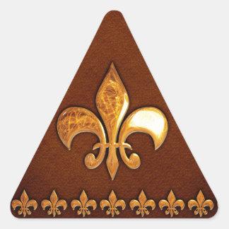 Gammalt läder täcker med guld- Fleur-de-Lys - Triangelformat Klistermärke
