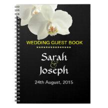 Gästen för vitOrchidbröllop noterar boken Anteckningsbok