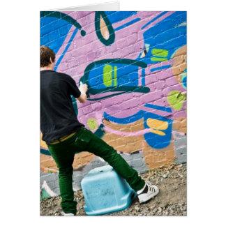Gatakonstnär som gör saker hälsningskort