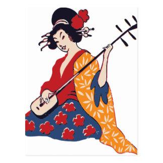 Geisha som leker en Shamisen Vykort