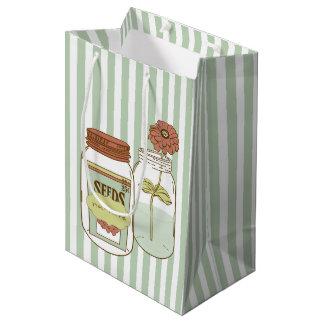 Giftbag för för fostranmasonburk och blomma