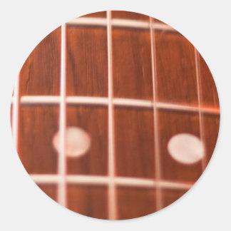 Gitarren stränger runt klistermärke