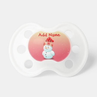 Gladlynt babysnögubbe med julhatten napp