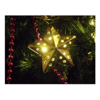 Glänsande ljus för helgdagstjärnajul vykort