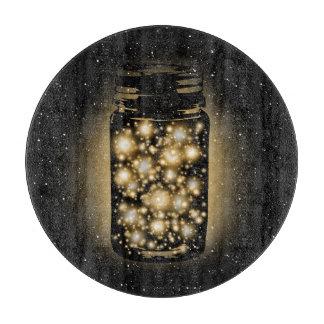 Glödande burk av Fireflies med nattstjärnor
