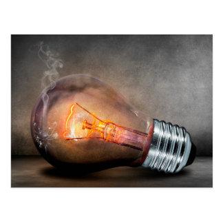 Glödande den ljusa kulan knäckt exponeringsglas vykort