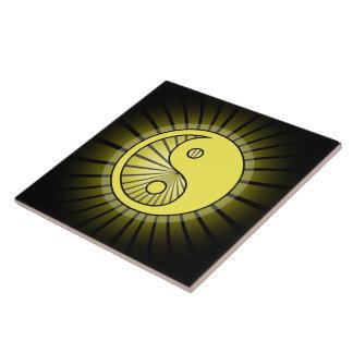 Glowing Yellow Yin Yang over Black