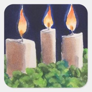 Glödande helgdagstearinljusklistermärkear fyrkantigt klistermärke