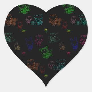 Glödande kattunge hjärtformat klistermärke