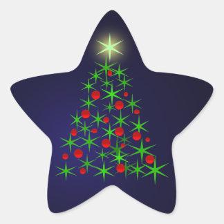 Glödande stjärnor på julgranen. Lyckliga Holidays. Stjärnformat Klistermärke