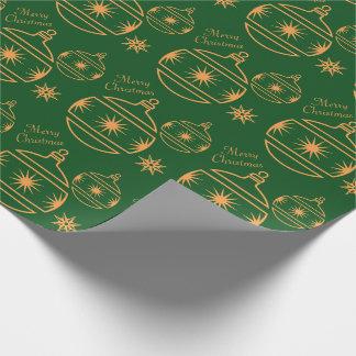 God julprydnadar på grönt presentpapper