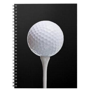 Golfboll & utslagsplats på svarten - skräddarsy anteckningsbok med spiral