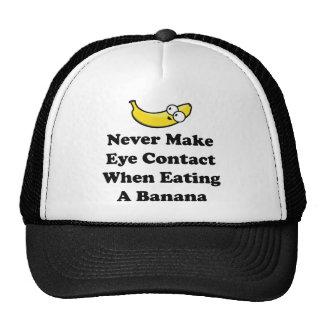 Gör aldrig ögat att kontakta, när du äter en banan keps
