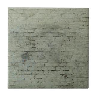 Grå färg målad bakgrund för tegelstenväggstruktur kakelplatta