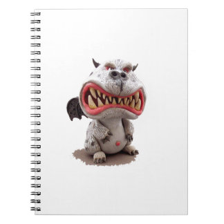 Grå färgdrake med den flina öppna munnen för arg anteckningsbok med spiral