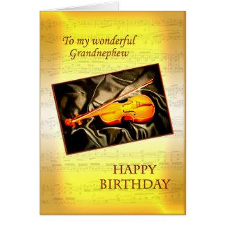 Grandnephew ett musikaliskt födelsedagkort med en hälsningskort