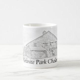 Granit parkerar den jubileums- muggen för chaleten kaffemugg