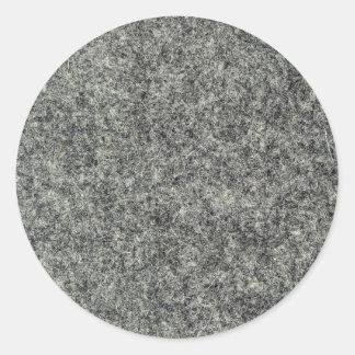 Grått klädde med filt tyg rund klistermärke