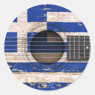 Grekisk flagga på den gammala akustiska gitarren runt klistermärke
