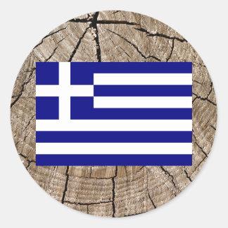 Grekisk flagga på trädskäll runt klistermärke