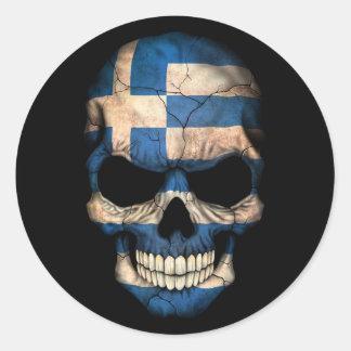Grekisk flaggaskalle på svart rund klistermärke