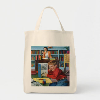 Groda i bibliotek mat tygkasse