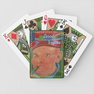 Grön cykel som leker kort spelkort