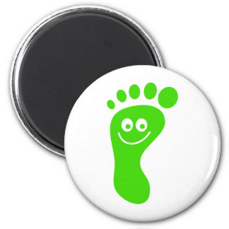 Grön fot för lycklig magnet