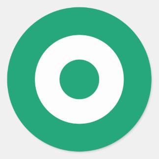 Grön modrundaklistermärke runt klistermärke