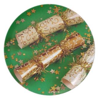 Grön och guld- juldekoration pläterar tallrik
