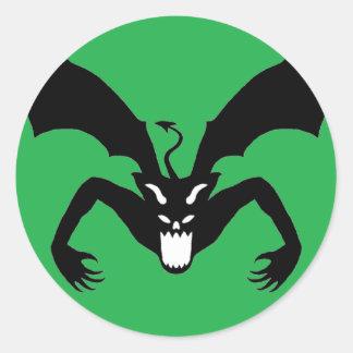 Grön och svart djävulen runt klistermärke