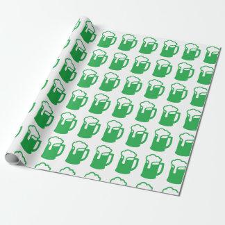 Grön öl som slår in papper presentpapper