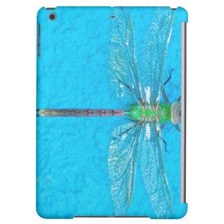 Grön slända för makro på blåttbakgrund