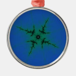 Grön stjärna på blått julgransprydnad metall
