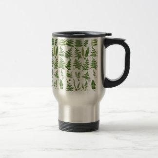 Gröna lövrika växter för vintage rostfritt stål resemugg