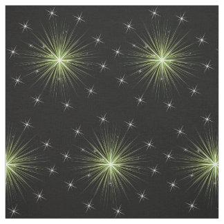 Gröna stjärnor på svart tyg
