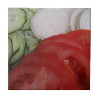 Grönsaker belägger med tegel kakelplatta