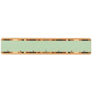 Grönt damastast mönster nyckelhängare