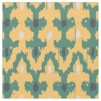 Grönt geometriskt Ikat för orange dekorativt Tyg
