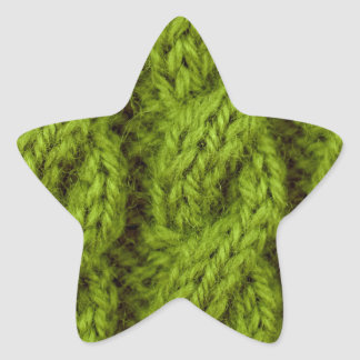 Grönt kabelhandarbete stjärnformat klistermärke