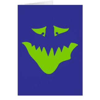 Grönt läskigt ansikte för limefrukt. Monster. Hälsningskort