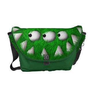 Grönt läskigt hårigmonster kurir väska
