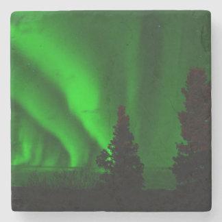 Grönt nordligt ljus underlägg sten