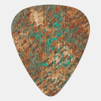 Grönt och rostar det abstrakt fläckiga plektrum