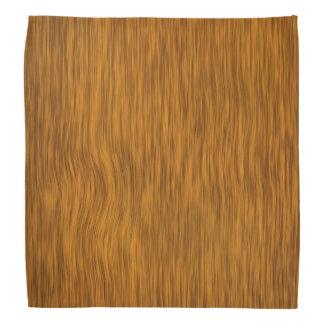 Grovt trä med den guld- fullföljandebandanaen scarf