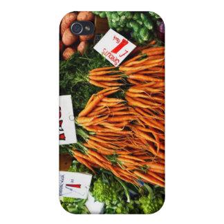 Grupper av morötter och grönsaker marknadsför på iPhone 4 fodral