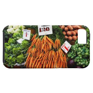 Grupper av morötter och grönsaker marknadsför på iPhone 5 skal