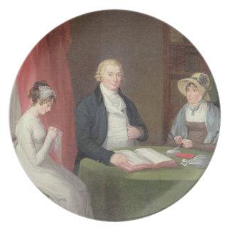 Gruppporträtt på ett teckningrumbord (olja kan på fest tallrikar