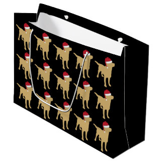 Gul Labrador Retriever i den röda Santa hatten